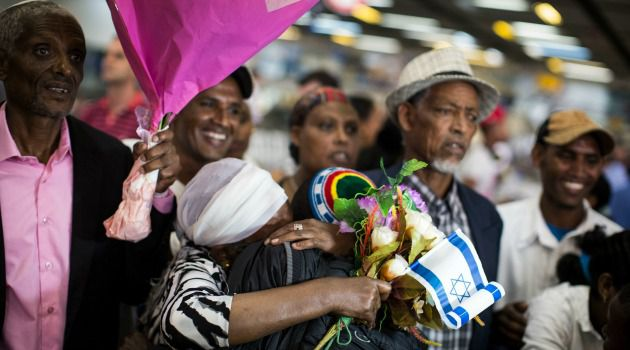 Welcome to Israel: Israeli relatives welcome Ethiopian Jews arriving in Tel Aviv.