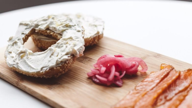 At the café in the Jewish Museum of Montreal, a St-Viateur bagel is served with preserved lemon cream cheese, ras-al hanout-spiced gravlax and pickled onions.