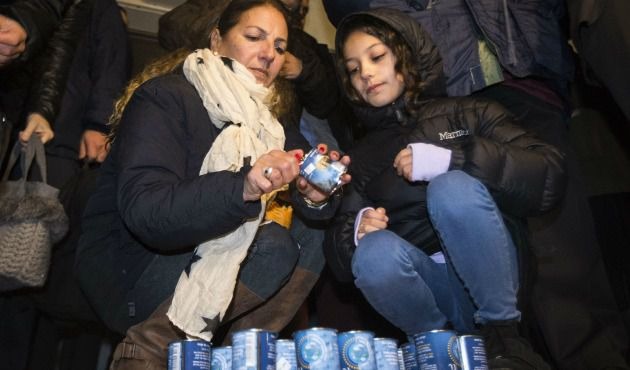 Mourning: French-Israeli dual nationals light candles during a remembrance ceremony in Tel Aviv, in tribute to the victims of the Islamist killing spree in Paris.
