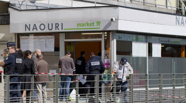 Bomb Probe: French police investigate scene of bombing at Jewish store outside Paris.