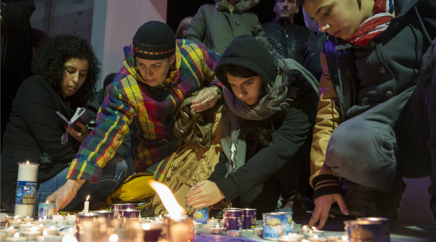 Growing Community: French Israelis light candles in the coastal city of Netanya to mourn the victims of the Paris terror attacks.