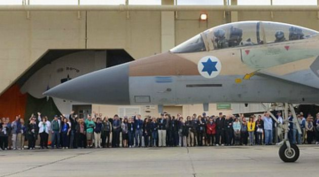 Fly High: Friends of the IDF supporters cheer an Israeli military plane.
