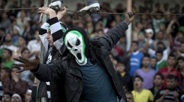 No End in Sight: A Gaza soccer fan celebrates his team's win in a local tournament. The Palestinian enclave's economy is worse than ever, choked by both Israel and Egypt.