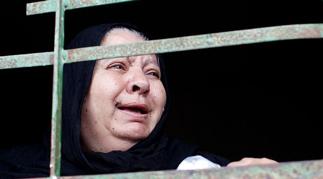 Mournig: Palestinian woman mourns at funeral for mentally ill Gaza woman shot dead by Israeli soldiers.