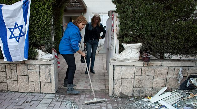 Cleaning Up: Israelis clean up after latest rocket attacks from Gaza.