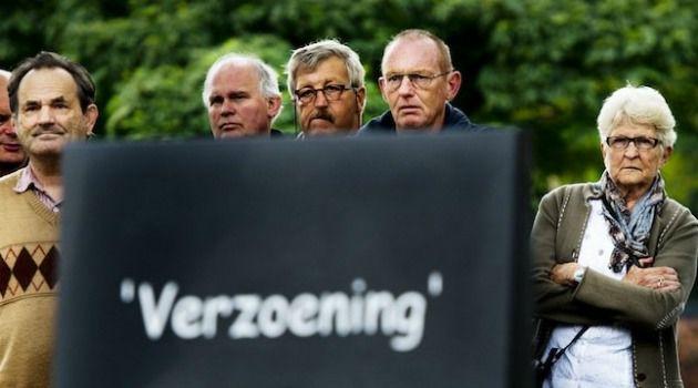 Visitors gaze at a Dutch memorial for World War II victims.