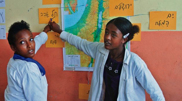 Geography Class: Ethiopian Jewish students locate cities on a map of Israel at the Jewish Agency school in Gondar.