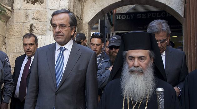 No Kippah: Greek Prime Minister Antonis Samaras visits the Church of the Holy Sepulchre in Jerusalem. When he got to Yad Vashem, he refused to don a yarmulke.