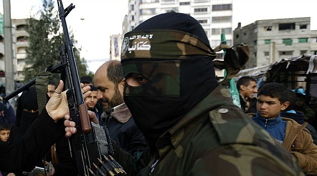 Hamas militant marches in Gaza military parade.