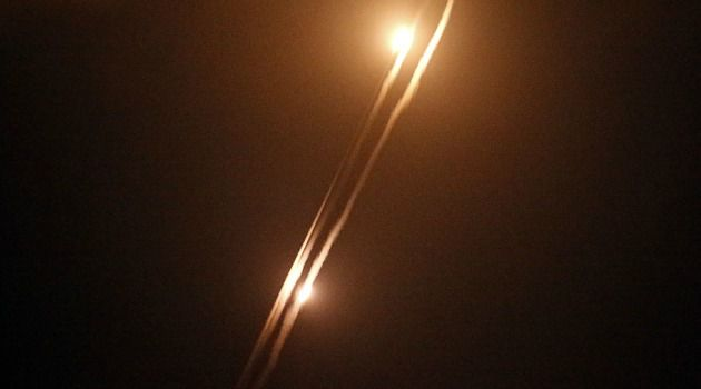 Whose Property? Palestinian Hamas-made rockets are fired toward Israel from the center of Gaza City.