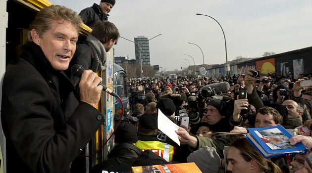 ?Der Hoff?: David Hasselhoff greets thousands of Germans who turned out for a rally against pulling down a slice of the old Berlin Wall. Once a symbol of Communism, the wall has become a rallying cry for German unity and artistic freedom.