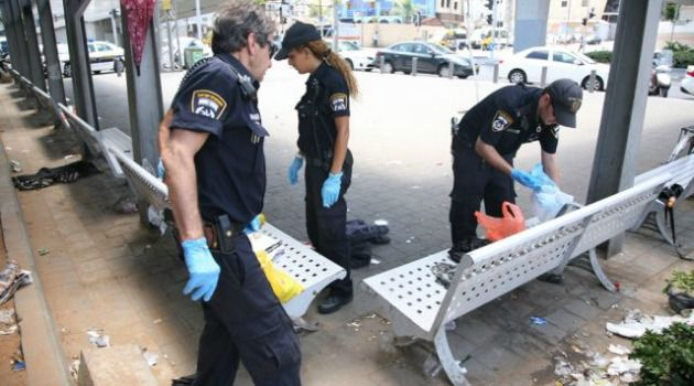 Gruesome Find: Police investigate the discovery of a women?s decapitated body in Tel Aviv.