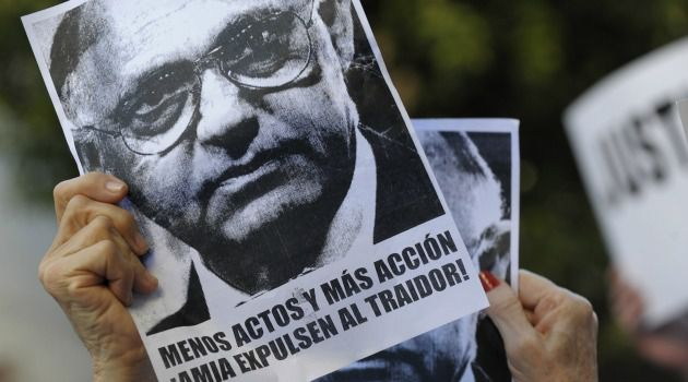 Demonstrators in Buenos Aires call for the ouster of Hector Timerman, the foreign minister accused by prosecutor Alberto Nisman, whose recent shooting death is unsolved.