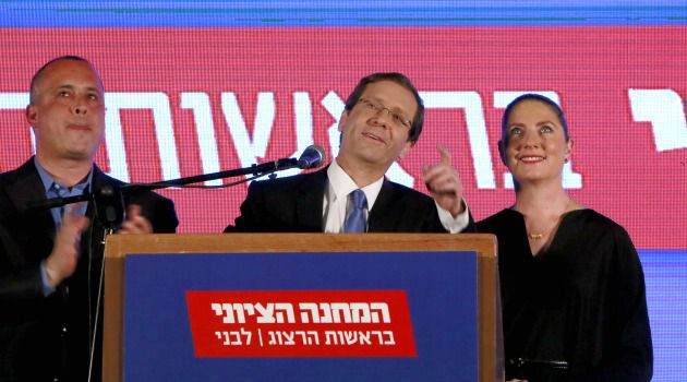 Defeated: Isaac Herzog delivers a speech next to his wife Michal as he reacts to exit poll figures in Israel's parliamentary elections.
