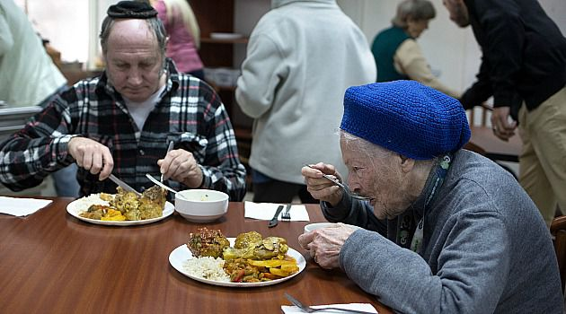 Still Surviving: Holocaust survivor Shoshana Colmer eats with her son in a home in Israel. As survivors age, fewer can share the memories of the horrors they lived through.