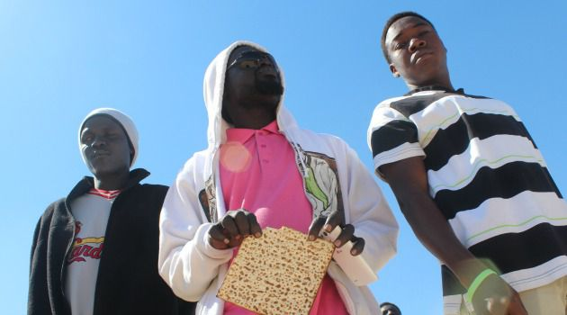 Matzo Means Hope: African immigrants celebrate a mock Seder at the detention center where they are being held in the Negev Desert.
