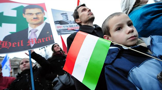No to Neo-Nazis: A Hungarian boy carries the country?s flag at a rally to denounce the far right Jobbik Party.