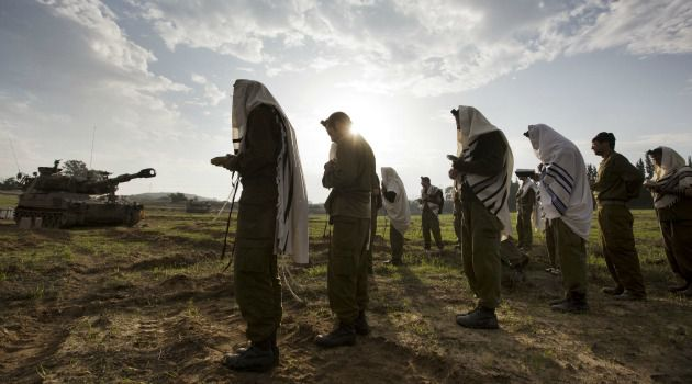 Wary Relief: Israeli soldiers remain massed along the Gaza border, despite the ceasefire that appeared to be holding.