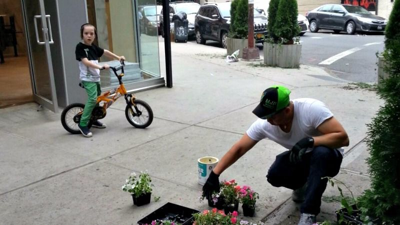 Volunteers planted flowers outside the new location this summer.