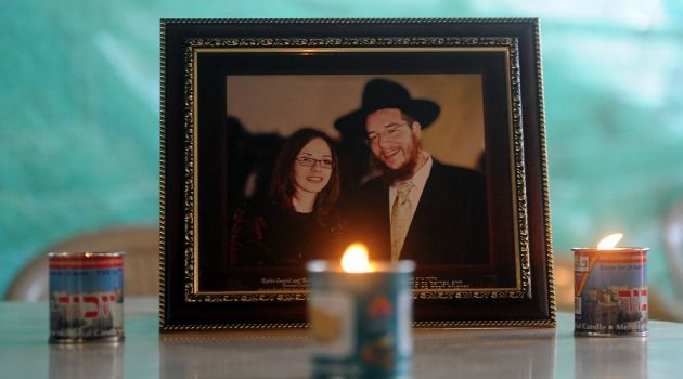 Scene of Trauma: Memorial candles are seen placed in front of a photograph of slain Rabbi Gavriel Holtzberg and his wife Rivkah, at the Chabad (Nariman) house in Mumbai, which Islamist militants stormed in 2008.