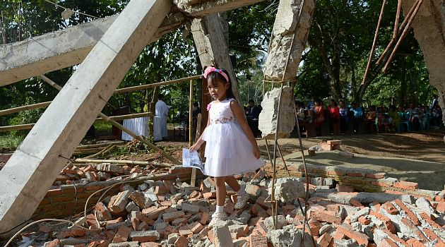 Look Like Tolerance? An Indonesian girl walks through the ruins of a church in Bakasi that was destroyed on orders of the local government.