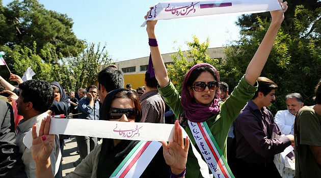 Tehran Cheers: Iranians rally to support Hassan Rouhani?s icebreaking phone call to Barack Obama. A handful of counterprotesters tossed eggs at the moderate leader.