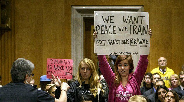 Demonstrators from the anti-war group Code Pink protest at congressional vote.