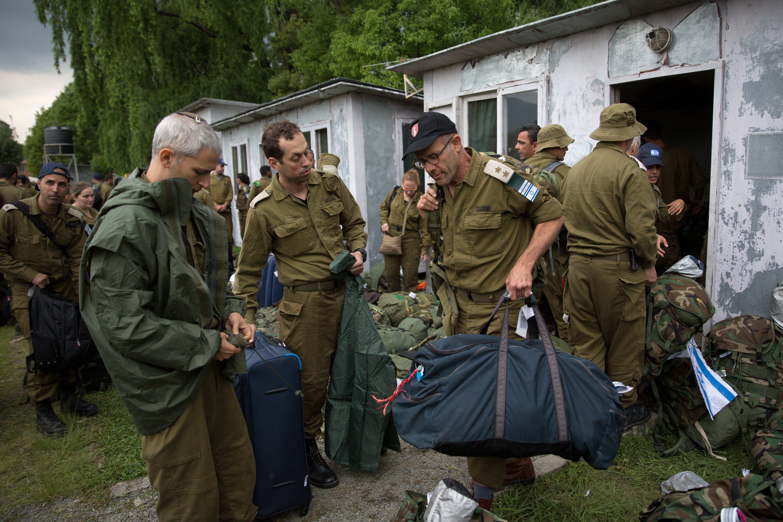 Israeli soldiers set up camp in earthquake-ravaged Nepal as stranded trekkers pleaded for more help.