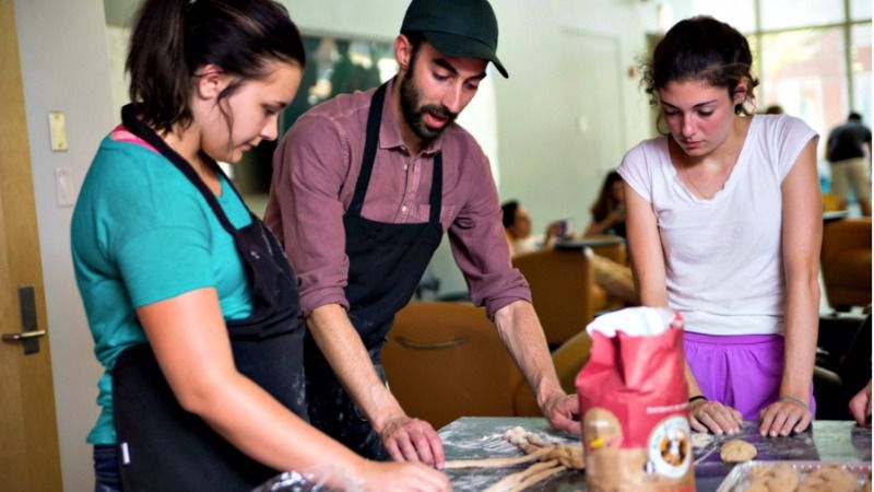 Jeffrey Yoskowitz (center) demonstrates challah braiding.