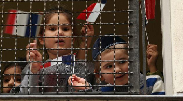 #JeSuisJuif: Jewish schoolchildren wave French flags during visit by French Interior Minister Bernard Cazeneuve.