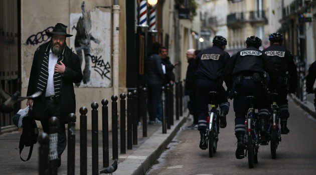 On Alert: Police patrol a Jewish neighborhood in France.