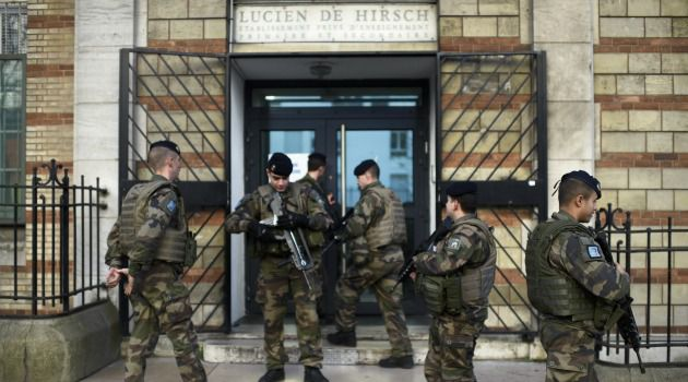 French soldiers patrol outside a Jewish school in Paris.