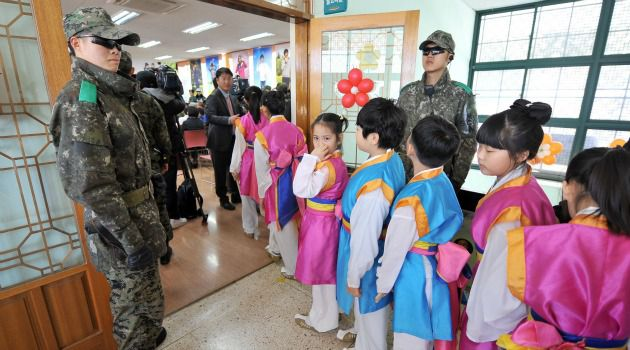 Harsh Lessons: South Korean soldiers guard a school near the border with North Korea, which recently testes its largest-ever nuclear weapon.
