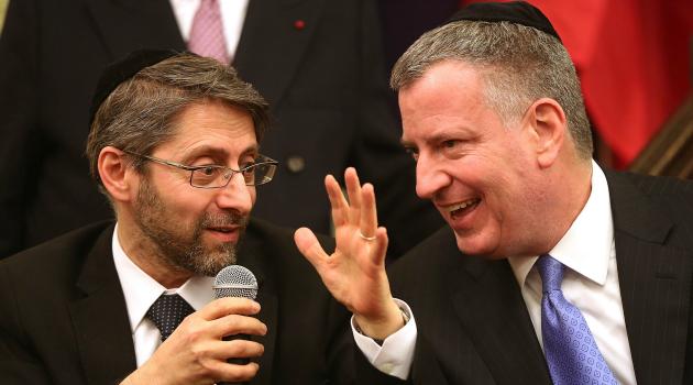 Manhattan Meeting: France's Chief Rabbi Haim Korsia chats with New York Mayor Bill De Blasio at Park East Synagogue.