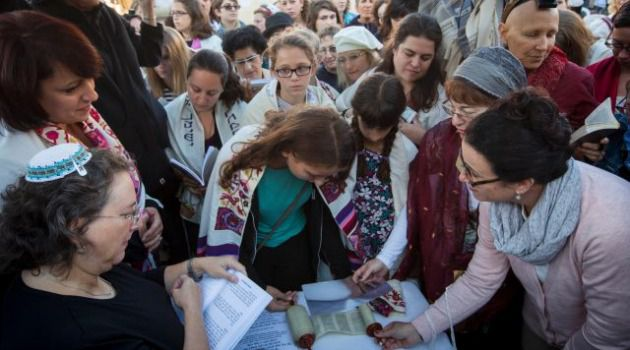 Teenage Pioneer : Bat mitzvah girl Sasha Lutt reads from a tiny Torah scroll smuggled into the Western Wall.