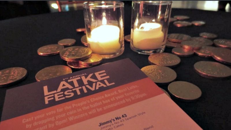 Hanukkah gelt glimmers on a table at the 8th-annual Latke Festival, which was held at the Brooklyn Museum.