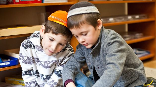Progressive Traditional Pre-K:  Two students work on a math lesson together at Luria Academy, an Open Orthodox Jewish Day School in Brooklyn.