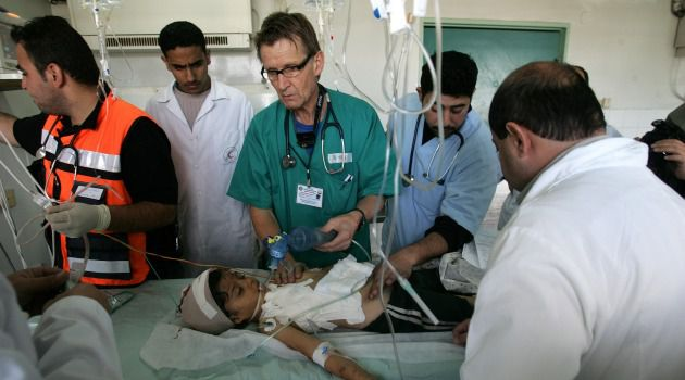 Banned: Norwegian professor Dr. Mads Gilbert, center, tends with local medical team to a Palestinian child wounded in an Israeli army operation in 2009 in Gaza City, Gaza.