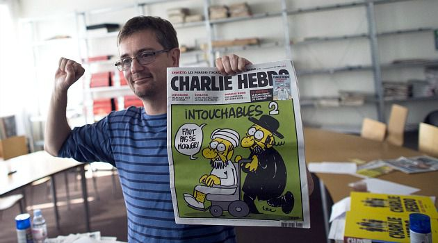 Free Speech? An editor shows front page of French satire magazine with cartoon depicting a Jew and the Prophet Muhammed.