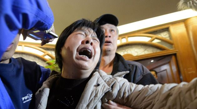 Unending Grief: A passenger?s relative weeps after authorities say they believe Malaysia Airlines Flight 370 crashed in Indian Ocean, killing all those aboard.