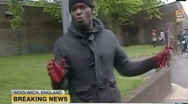 A Manifestation of Evil: Hands still bloody, the man who attacked a British soldier with a meat cleaver in London is shown on television footage.