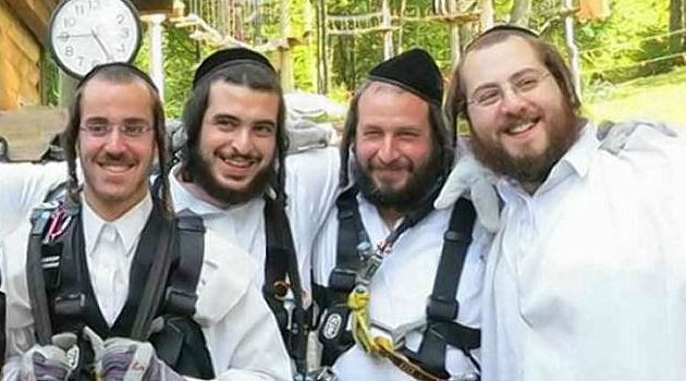 Better Days: Slain developer Menachem Stark, second from the right, enjoys joke with relatives.