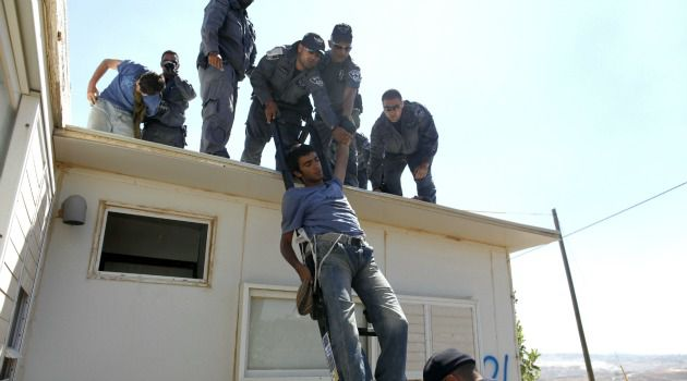Pulled Down: Israeli police evacuate illegal settlers from West Bank outpost of Migron.