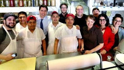 Mile End Deli staff with Prime Minister Justin Trudeau.