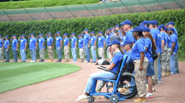 Back Home: Returning veterans are honored before a baseball game at Chicago?s Wrigley Field.