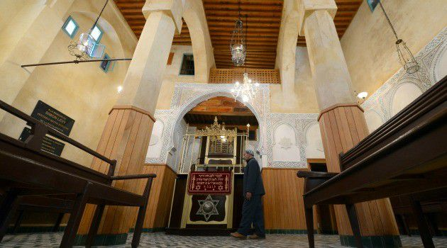 Ancient Roots: Moroccan Jew walks to the door of a synagogue in the northern city of Fez. A museum devoted to the country?s Jewish culture has reopened in Casablanca after renovations.