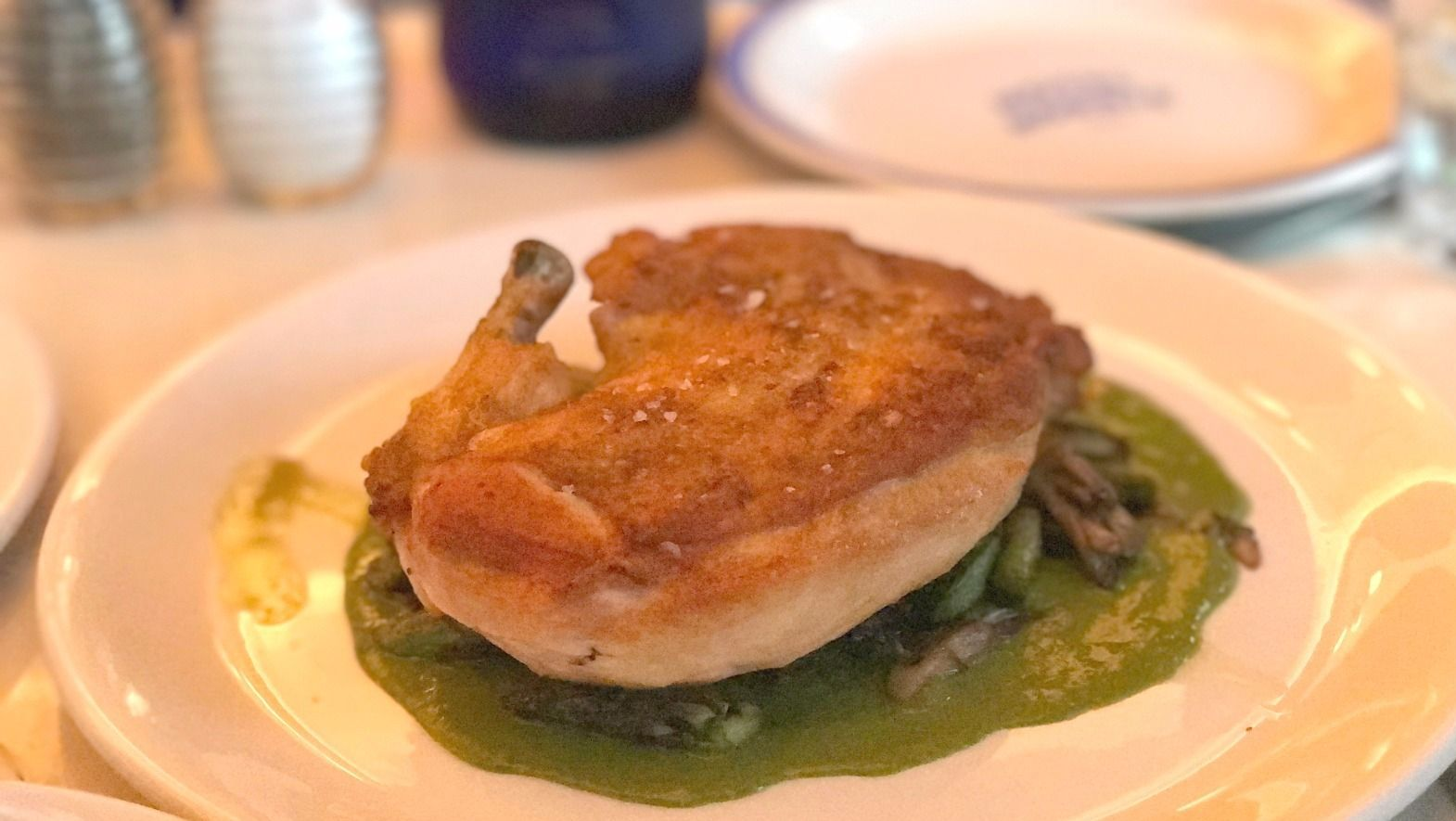 Spring Chicken: Moist, juicy oven-roasted chicken rests atop a garlic purée and spring vegetables.