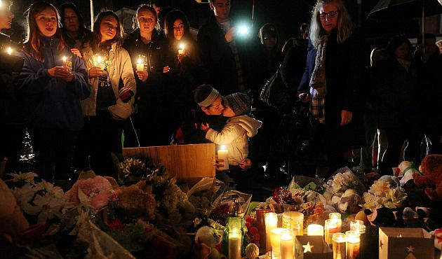 Hug Your Kids: Mourners light candles at memorial for victims of massacre in Newtown, Conn.