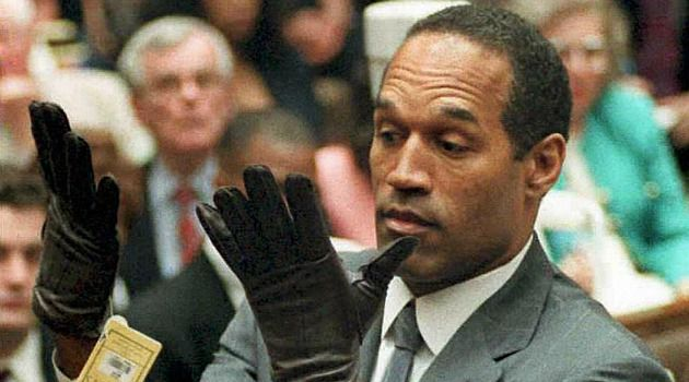 You Must Acquit: O.J. Simpson struggles to put on glove in famed episode of 1995 murder trial.