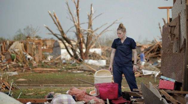 Deadly Twister: A woman surveys damage after devastating tornado ripped through an Oklahoma City suburb.